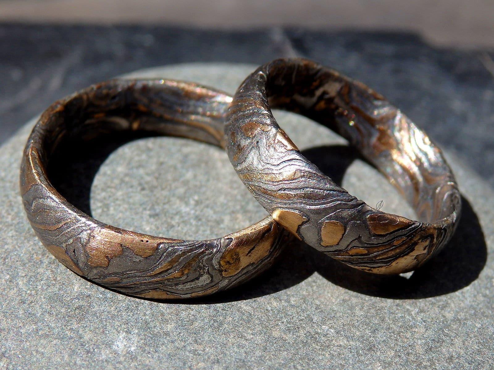 Trauringe Mokume Gane Rotgold 585 Palladium 500 Silber geätzt