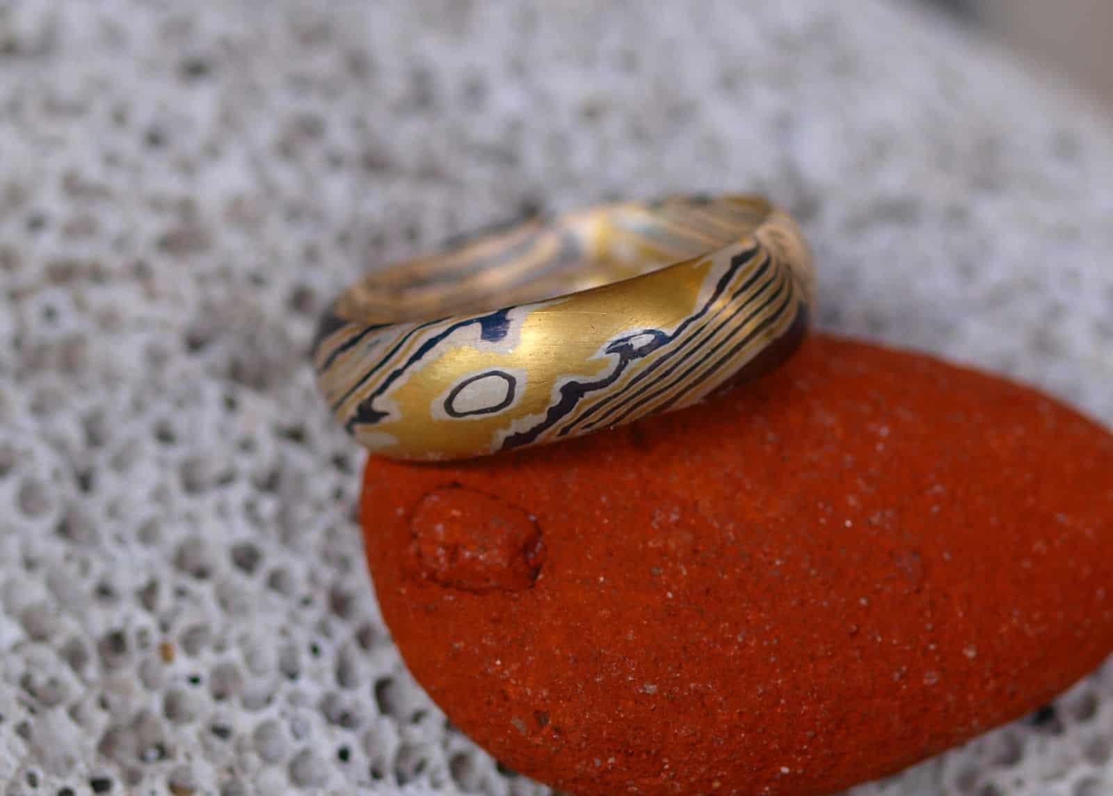 Mokume Gane Ring Gold 900 Palladium 500 Silber 925 Holzmaserung mit Augen Unikat